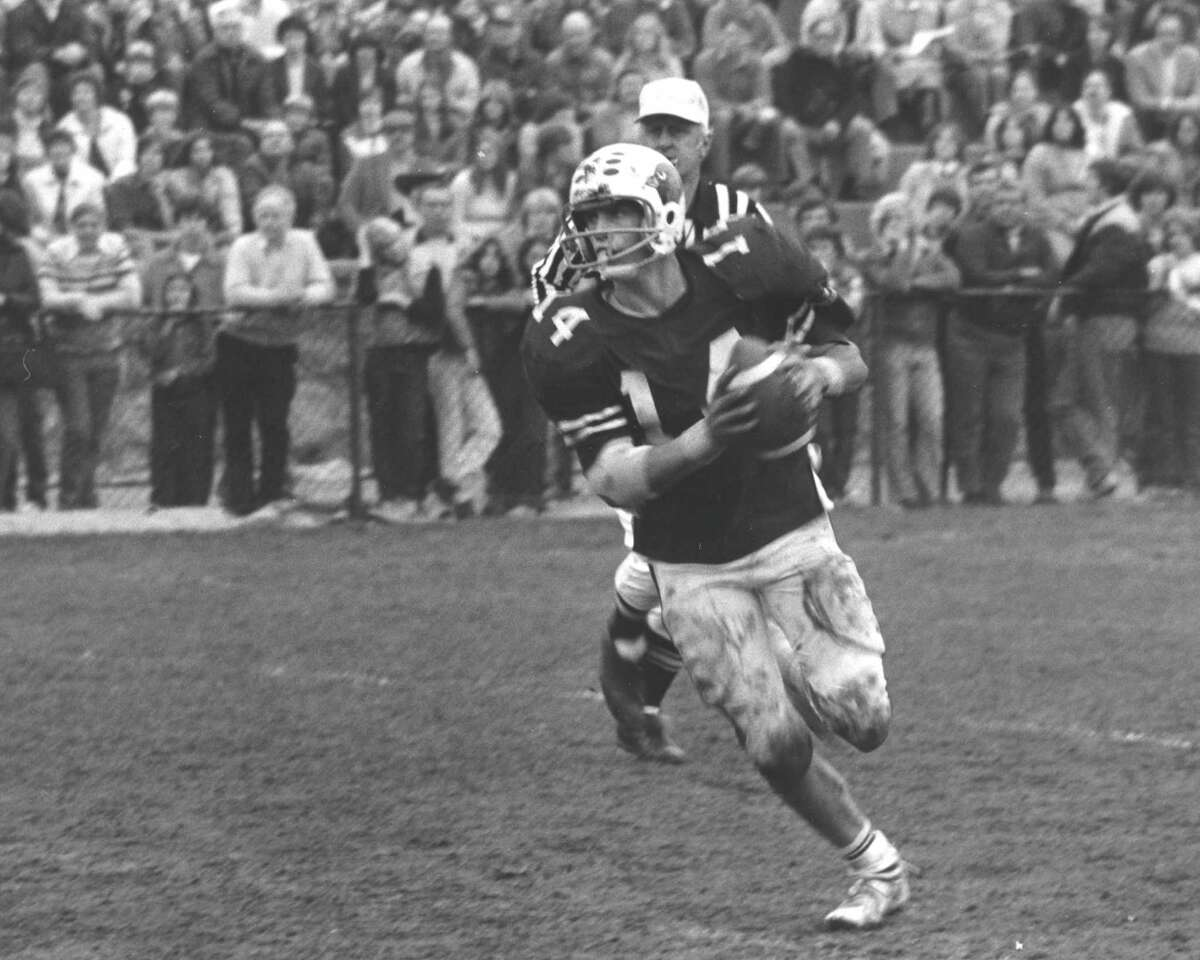 Steve Young scrambles as quarterback for the Greenwich High School football team in a game against Darien High School in November 1979.