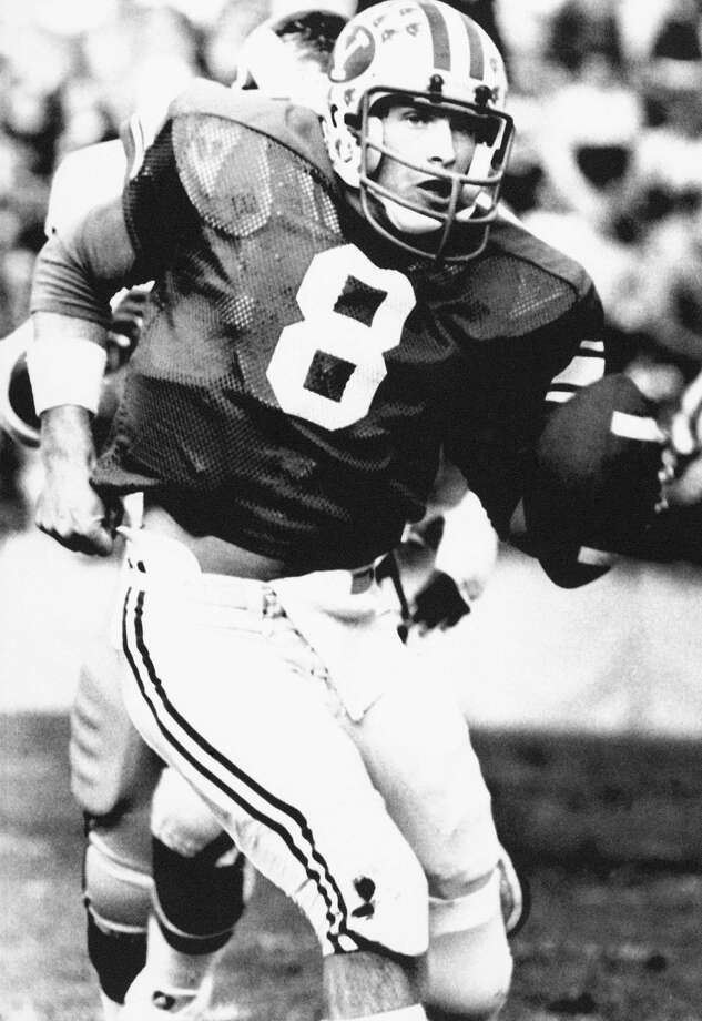 Quarterback Steve Young from Brigham Young University scrambles out of trouble in the second quarter of the BYU-Colorado State game in Provo, Utah, Nov. 12, 1983.  (AP Photo) Photo: AP / 1983 APAssociated Press