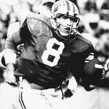 Quarterback Steve Young from Brigham Young University scrambles out of trouble in the second quarter of the BYU-Colorado State game in Provo, Utah, Nov. 12, 1983.  (AP Photo)