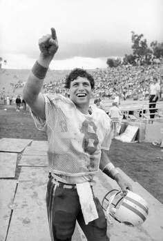 """Brigham Young University quarterback Steve Young responds to BYU fans with a """"Number One"""" show of the finger as he departs the field after leading his team to a 37-35 victory over UCLA at the Pasadena Rose Bowl, Oct. 1, 1983. (AP Photo/Doug Pizac) Photo: Doug Pizac, AP / 1983 APAssociated Press"""