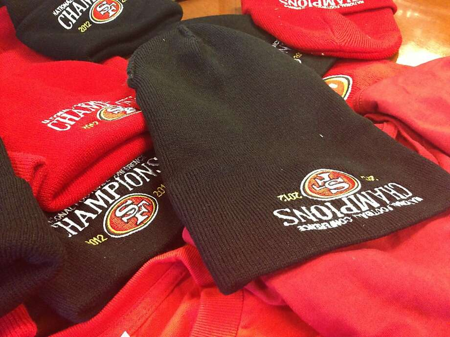 Counterfeit 49ers gear is shown on Thursday, Jan. 31, 2013, in San Francisco, Calif. The gear often includes visible errors, such as the backward and upside-down logo on the beanie. Photo: Ellen Huet, The Chronicle