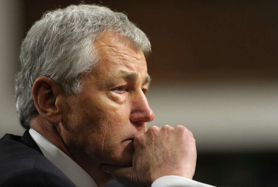Republican Chuck Hagel, President Obama's choice for defense secretary, testifies before the Senate Armed Services Committee during his confirmation hearing, on Capitol Hill in Washington, Thursday, Jan. 31, 2013. (AP Photo/Susan Walsh) Photo: Susan Walsh