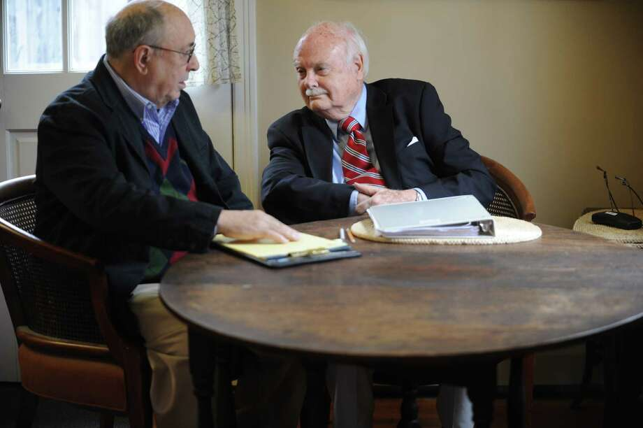 Marven Moss, the fellow who is his right-hand and Ian Kerr, founder of Memoir scribes, works together at Kerr's home in Riverside, Conn., Wednesday, Jan. 30, 2013. They and six other former journalists will write the memoirs of clients and also provide a genealogy or video upon request. Photo: Helen Neafsey / Greenwich Time