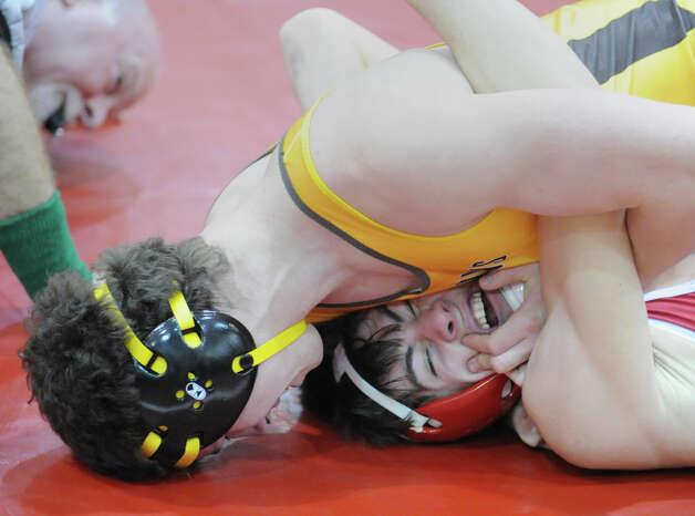 At top, Connor Kupersmith during the 152 pound match he won against Erik Tack of Greenwich in the boys high school wrestling match between Greenwich High School and Brunswick School at Greenwich, Thursday night, Jan. 31, 2013. Photo: Bob Luckey / Greenwich Time