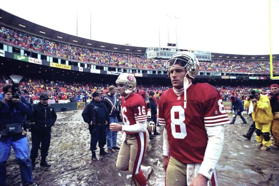 Steve Young, foreground, and Joe Montana leave the field after losing to the Cowboys.  Photo taken January 17, 1993.