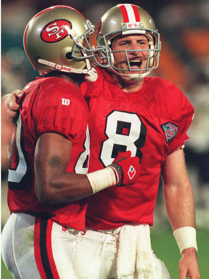San Francisco 49ers quarterback Steve Young (R) celebrates with teammate Jerry Rice (L) after Young threw his fifth touchdown pass 29 January 1995 during Super Bowl XXIX. The 49ers defeated the San Diego Chargers 49-26 and became the first NFL team to win five Super Bowls. Photo: JEFF HAYNES/AFP/Getty Images, Getty / JEFF HAYNES/AFP/Getty ImagesConnecticut Post contributed
