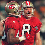 San Francisco 49ers quarterback Steve Young (R) celebrates with teammate Jerry Rice (L) after Young threw his fifth touchdown pass 29 January 1995 during Super Bowl XXIX. The 49ers defeated the San Diego Chargers 49-26 and became the first NFL team to win five Super Bowls.