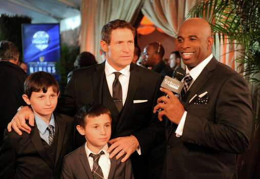 Deion Sanders, right, interviews Steve Young before the inaugural NFL Honors show Saturday, Feb. 4, 2012, in Indianapolis. Photo: Newman Lowrance, (AP Photo/Newman Lowrance) / 2012 APAssociated Press