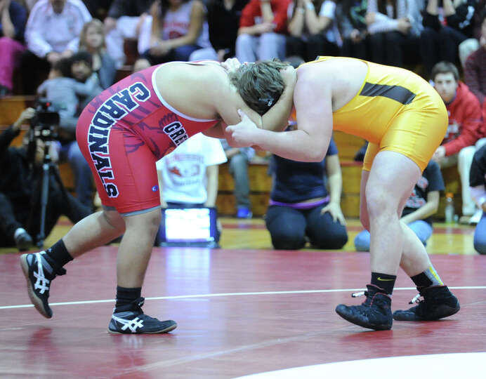 Will Rosato(in gold) of Brunswick during the 220 pound match that he won against Erik Menchaca of Gr