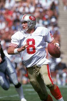 Quarterback Steve Young #8 of the San Francisco 49ers looks to pass against the Los Angeles Raiders during a game at the Los Angeles Memorial Coliseum on September 29, 1991 in Los Angeles, California.  The Raiders won 12-6.  (Photo by George Rose/Getty Images) Photo: George Rose, ST / 1991 Getty Images