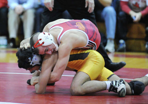 Alex Margeotes (in red) during the 113 pound match that he won on a pin against Rohan Das of Brunswick in the boys high school wrestling match between Greenwich High School and Brunswick School at Greenwich, Thursday night, Jan. 31, 2013. Photo: Bob Luckey / Greenwich Time