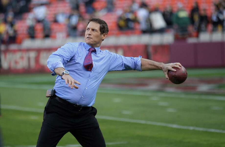 Former San Francisco 49ers quarterback Steve Young throws a football before an NFL football game between the San Francisco 49ers and the Pittsburgh Steelers in San Francisco, Monday, Dec. 19, 2011. (AP Photo/Marcio Jose Sanchez) Photo: Marcio Jose Sanchez, Associated Press / AP