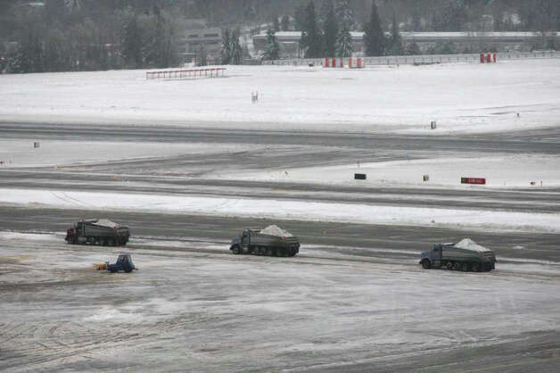 Trucks remove snow and ice at Seattle-Tacoma International Airport on Thursday, January 19, 2012, after a big ice storm hit the region.  Photo: JOSHUA TRUJILLO / SEATTLEPI.COM