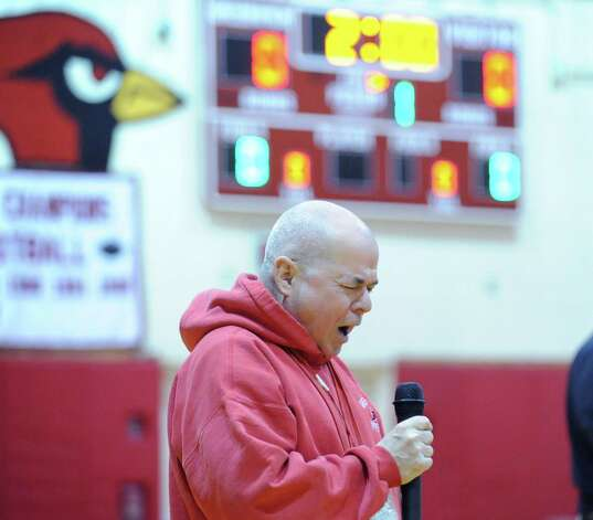 Dick Leonard belts out the National Anthem prior to the boys high school wrestling match between Greenwich High School and Brunswick School at Greenwich, Thursday night, Jan. 31, 2013. Photo: Bob Luckey / Greenwich Time