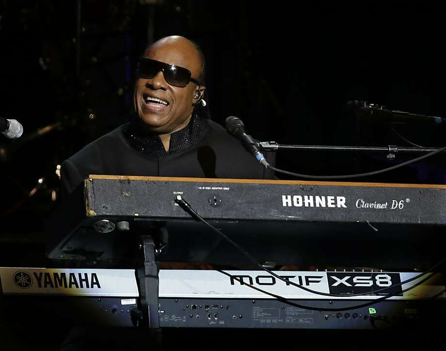 Stevie Wonder will sing Saturday night and is featured in two commercials. Photo: Paul Sancya, Associated Press