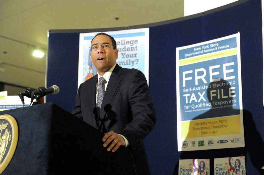 ThomasMattox, New York State Commissioner of Taxation and Finance addresses those gathered for a press event on the new ?Free File? Tax Site located on the Empire State Plaza Concourse on Thursday, Jan. 31, 2013 in Albany, NY.  The tax kiosk will serve individuals and families with incomes below $57,000.  Eligible taxpayers can electronically file their income taxes for free and receive free assistance from New York State Tax Department employees and IRS-certified volunteers from Albany Law School.  People can dial 211 in the Capital District to find out more.  (Paul Buckowski / Times Union) Photo: Paul Buckowski  / 00020982A