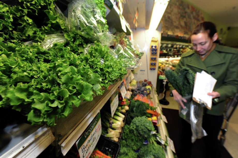 Jamecyn Morey of Albany shops for greens at the Honest Weight Food Co-op on Thursday Jan. 31,2013 in Albany, N.Y. (Michael P. Farrell/Times Union) Photo: Michael P. Farrell