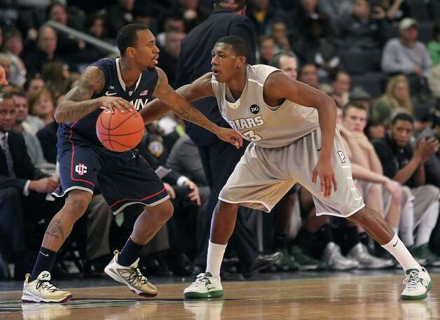 Providence guard Kris Dunn defends Connecticut guard Ryan Boatright, left, during the first half of an NCAA college basketball game, Thursday, Jan. 31, 2013, in Providence, R.I. (AP Photo/Stew Milne) Photo: Stew Milne, Associated Press / FR56276 AP
