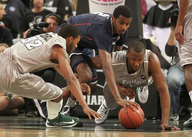 Providence guard Vincent Council (32) forward Kadeem Batts, right, and Connecticut forward DeAndre Daniels (2) battle for the loose ball during the first half of an NCAA college basketball game, Thursday, Jan. 31, 2013, in Providence, R.I. (AP Photo/Stew Milne) Photo: Stew Milne, Associated Press / FR56276 AP