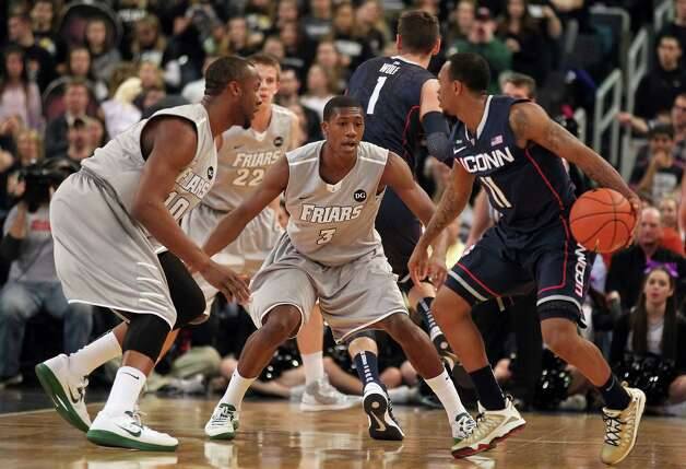 Providence guard Kris Dunn (3) and forward Kadeem Batts (10) defend against Connecticut guard Ryan Boatright (11) during the first half of an NCAA college basketball game, Thursday, Jan. 31, 2013, in Providence, R.I. (AP Photo/Stew Milne) Photo: Stew Milne, Associated Press / FR56276 AP