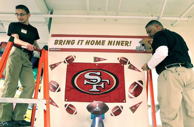 L to R Kevin Cram and George Mejia Party City employees build a 49ers display. San Francisco 49ers fans are stocking up on party supplies from new TV's to Mylar balloons. Thursday, Jan. 31, 2013 in San Francisco California. Photo: Lance Iversen, The Chronicle