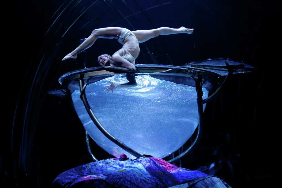 """Ikhertsetseg Bayarsaikhan performs in the """"Water Bowl"""" during Cirque du Soleil's Amaluna on Wednesday, January 30, 2013 at Marymoor park in Redmond. The spectacle features aerial performers, dancers, gymnasts, performers in the bowl of water and an incredible balancing act. The show continues until March 24th under the big top in Redmond. Photo: JOSHUA TRUJILLO, SEATTLEPI.COM / SEATTLEPI.COM"""