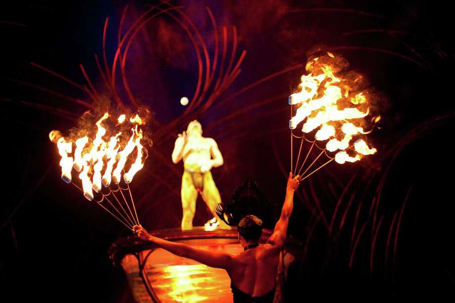 Amy McClendon holds fire as Viktor Kee juggles during Cirque du Soleil's Amaluna at Marymoor park in Redmond. The show continues until March 24th under the big top in Redmond. Photo: JOSHUA TRUJILLO, SEATTLEPI.COM / SEATTLEPI.COM