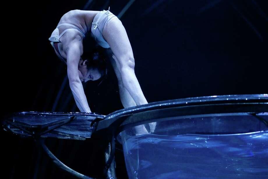 Ikhertsetseg Bayarsaikhan performs on the edge of the Water Bowl during Cirque du Soleil's Amaluna. Photo: JOSHUA TRUJILLO, SEATTLEPI.COM / SEATTLEPI.COM