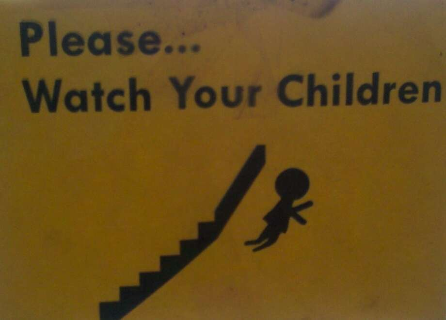Please keep an eye on your children -- or they may learn to fly. Location unknown. Photo: C/Signspotting.com