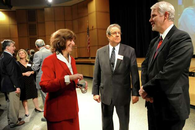 Marie Wiles, superintendent of Guilderland Central School District, left, Rick Timbs, executive director of Statewide School Finance Consortium, center, and Charles Dedrick, district superintendent and CEO of Capital Region BOCES, talk before the presentation Your Public Schools in Fiscal Peril ? Running Out of Time and Options on Thursday, Jan. 31, 2013, at Columbia High in East Greenbush, N.Y. (Cindy Schultz / Times Union) Photo: Cindy Schultz / 00021002A