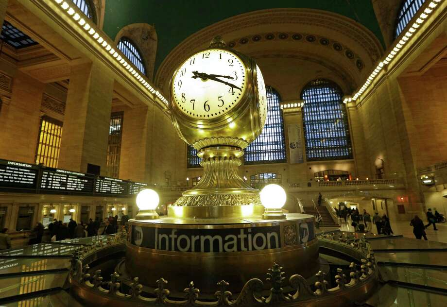 FILE- In this Jan. 9, 2013 file photo, the famous opalescent clock keeps time at the center of the main concourse in Grand Central Terminal is shown in New York.  The country's most famous train station and one of its finest examples of Beaux Arts architecture in America turns 100 on Feb. 1.  The building's centennial comes 15 years after a triumphant renovation that  removed decades of grime and decay. (AP Photo/Kathy Willens, File) Photo: Kathy Willens