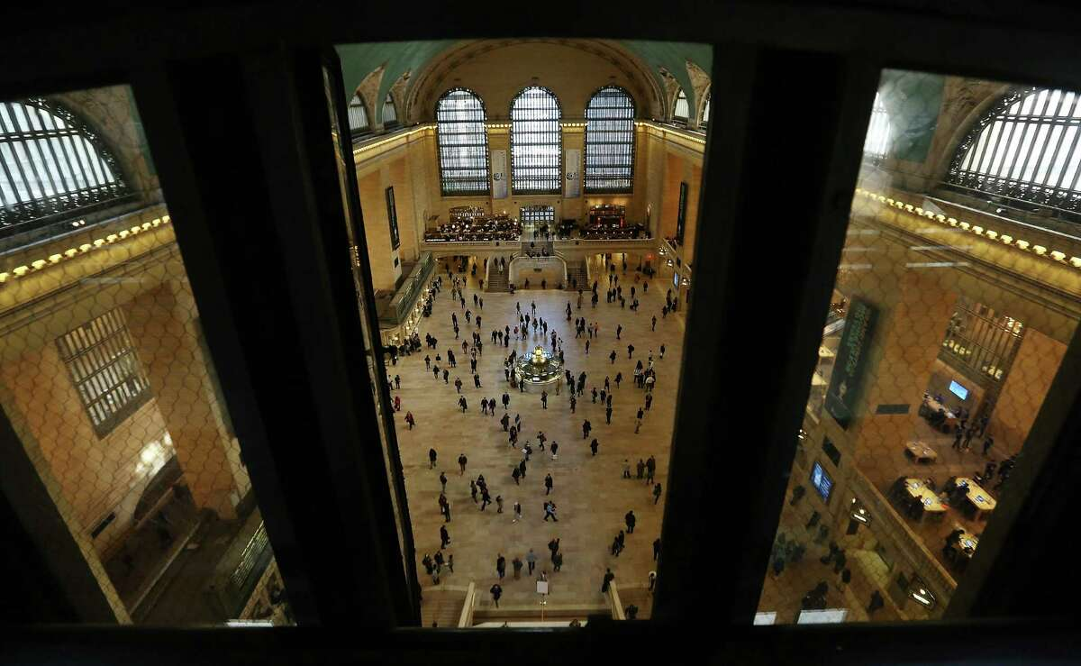 NEW YORK, NY - JANUARY 31: People walk through Grand Central Terminal on the day before the famed Manhattan transit hub turns 100 years old on January 31, 2013 in New York City. The terminal opened in 1913 and is the world's largest terminal covering 49 acres with 33 miles of track. Each day 700,000 people pass through the terminal where Metro-North Railroad operates 700 trains per day. (Photo by Mario Tama/Getty Images) *** BESTPIX ***