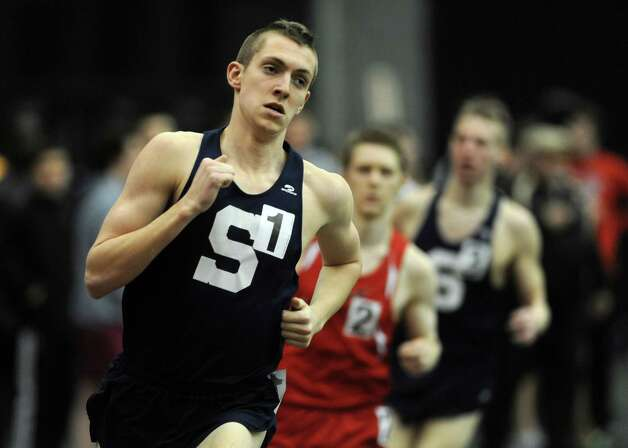 Staples' Henry Wynne races in the 1000 meter run Thursday, Jan. 31, 2013 during the FCIAC indoor track championships at the Floyd Little Athletic Center at Hillhouse High School in New Haven, Conn. Photo: Autumn Driscoll / Connecticut Post