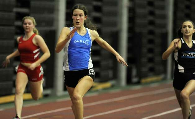 Darien's Catherine Lacy races in the 55 meter dash Thursday, Jan. 31, 2013 during the FCIAC indoor track championships at the Floyd Little Athletic Center at Hillhouse High School in New Haven, Conn. Photo: Autumn Driscoll / Connecticut Post