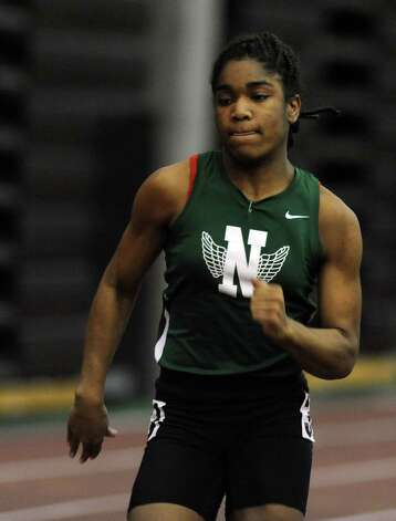 Norwalk's Tamia Taylor races in the 55 meter dash Thursday, Jan. 31, 2013 during the FCIAC indoor track championships at the Floyd Little Athletic Center at Hillhouse High School in New Haven, Conn. Photo: Autumn Driscoll / Connecticut Post