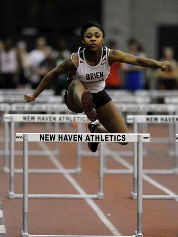 Brien McMahon's Sarah Boyd races in the 55 meter hurdles Thursday, Jan. 31, 2013 during the FCIAC indoor track championships at the Floyd Little Athletic Center at Hillhouse High School in New Haven, Conn. Photo: Autumn Driscoll / Connecticut Post