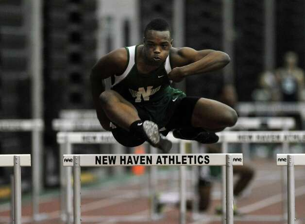 Norwalk's Hopeton Chambers races in the 55 meter hurdles Thursday, Jan. 31, 2013 during the FCIAC indoor track championships at the Floyd Little Athletic Center at Hillhouse High School in New Haven, Conn. Photo: Autumn Driscoll / Connecticut Post