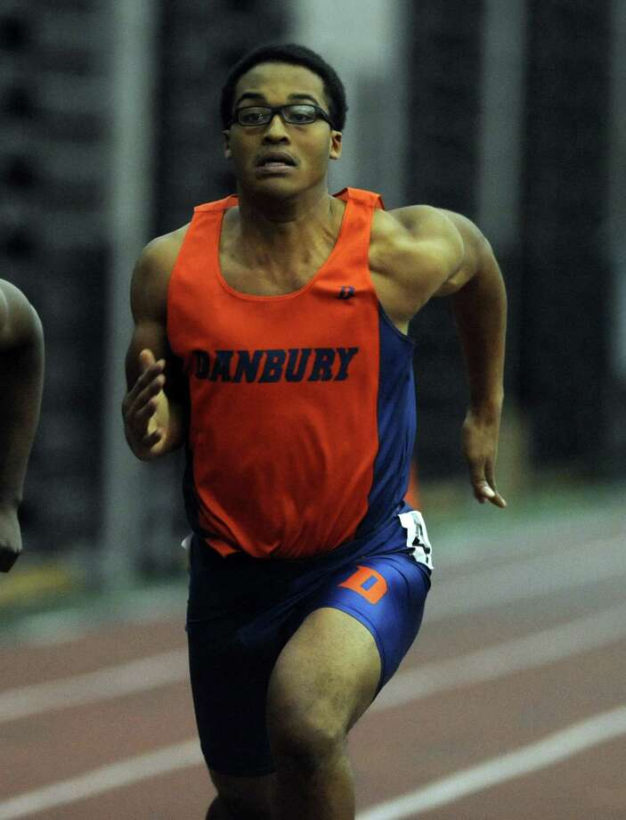 Danbury's Micaiah Hill races in the 55 meter dash Thursday, Jan. 31, 2013 during the FCIAC indoor track championships at the Floyd Little Athletic Center at Hillhouse High School in New Haven, Conn. Photo: Autumn Driscoll / Connecticut Post