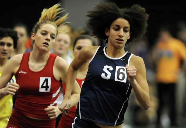 Staples' Erica Hefnawy races in the 1000 meter run Thursday, Jan. 31, 2013 during the FCIAC indoor track championships at the Floyd Little Athletic Center at Hillhouse High School in New Haven, Conn. Photo: Autumn Driscoll / Connecticut Post