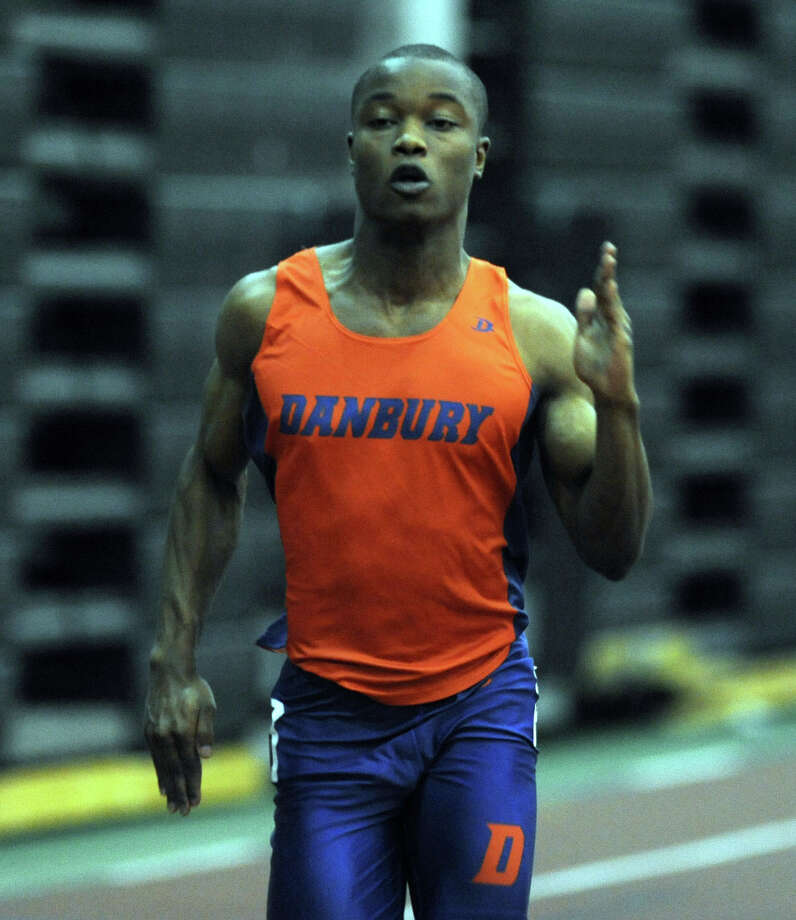 Danbury's Elijah Amoah races in the 55 meter dash Thursday, Jan. 31, 2013 during the FCIAC indoor track championships at the Floyd Little Athletic Center at Hillhouse High School in New Haven, Conn. Photo: Autumn Driscoll / Connecticut Post
