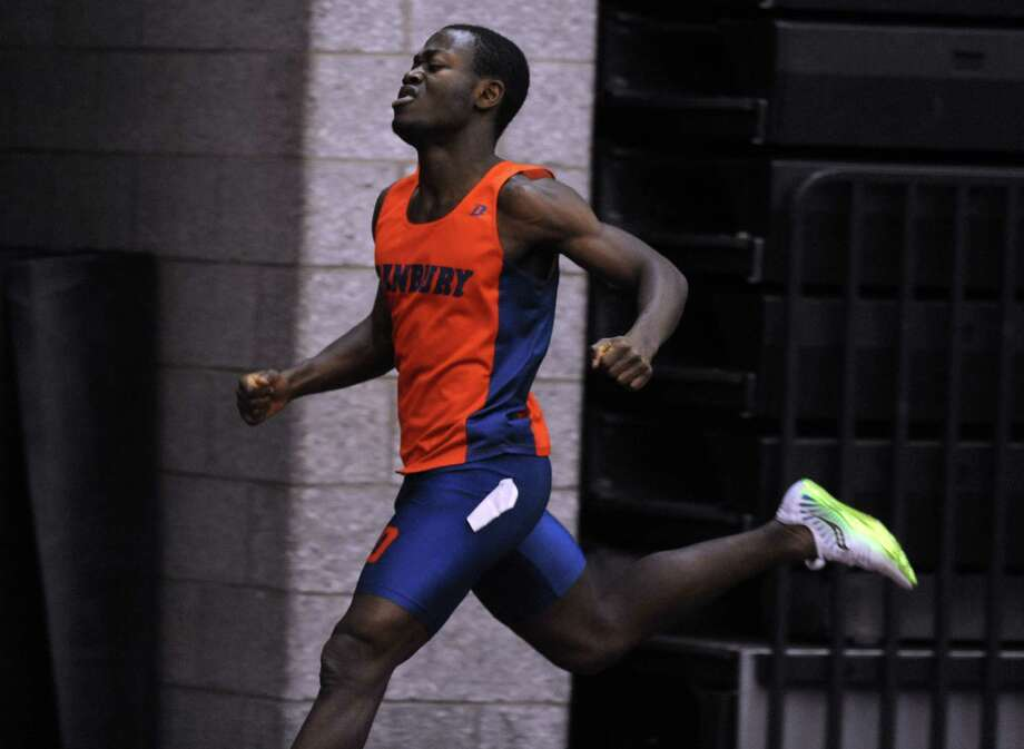 Danbury's Elijah Amoah finishes the 300 meter race in first place Thursday, Jan. 31, 2013 during the FCIAC indoor track championships at the Floyd Little Athletic Center at Hillhouse High School in New Haven, Conn. Photo: Autumn Driscoll / Connecticut Post