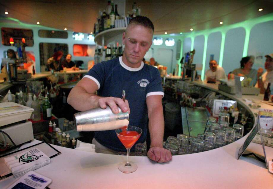 Bartender Brad Sentek makes a drink at Manray in 2003. Photo: GILBERT W. ARIAS, SEATTLE POST INTELLIGENCER