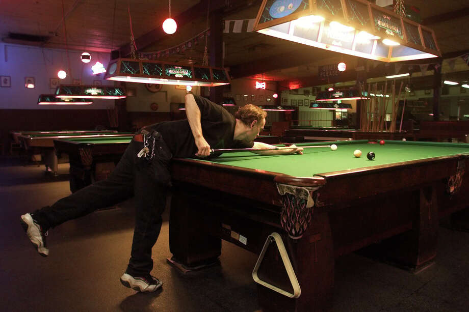 211 Club: Serious pool players hung out at this quiet Belltown place, which had no music and a sign that banned whistling and loud noises. Pictured is former 211 Club janitor Jay Murray, practicing his nine-ball after work. Photo: MIKE URBAN, SEATTLE POST-INTELLIGENCER