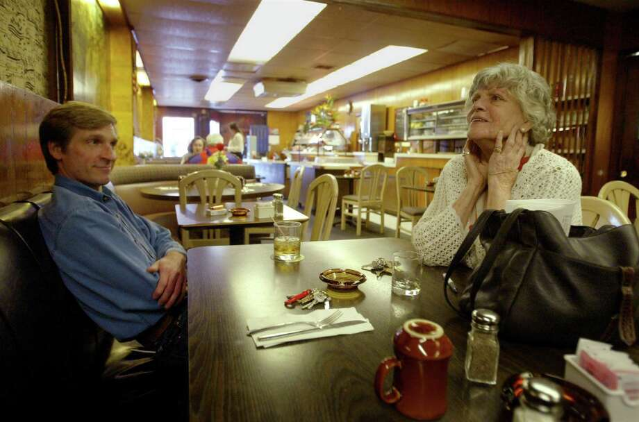 Sorry Charlie's was old-school Queen Anne. It was a piano bar on one side and dark hangout on the other, with old-timers filling both. Pictured is owner Betty Henderson (right) in 2003, talking about closing shop after almost 30 years with Drew Curry, owner of an Uptown floral shop that also closed. Photo: SCOTT EKLUND