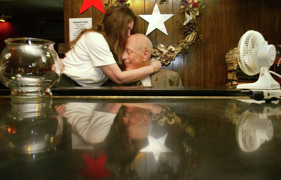 Before it closed, Sorry Charlie's featured legendary lounge piano player Howard Bulson, who is pictured here in 2003 getting a kiss from bartender Rose Stringer. Bulson died in 2007. Photo: MIKE URBAN, SEATTLE POST-INTELLIGENCER