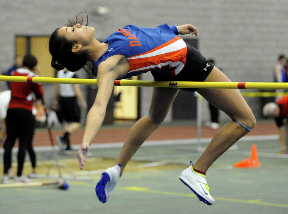Danbury's Lyzandra Fernandes competes in the high jump event during FCIAC Indoor Track and Field Championships in New Haven, Conn. on Thursday January 18, 2013. Fernandes finished in third place in the high jump and fourth in the pole vault.