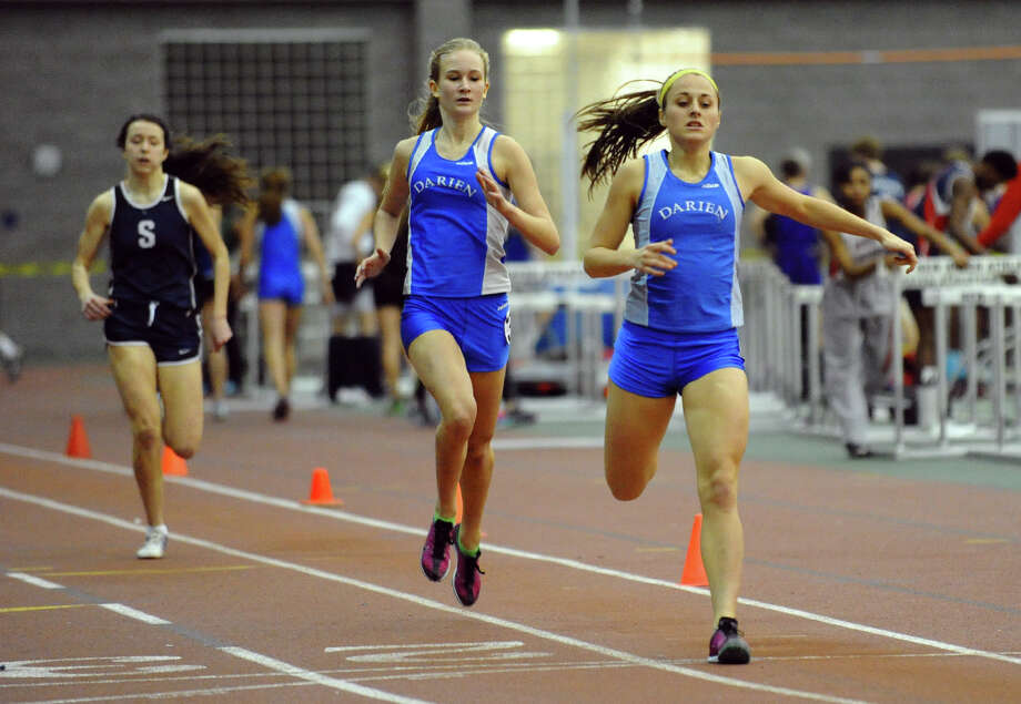 Darien's Dillon Schoen, right, crosses the finish line in frst place with teammate Anna Sulger crossing second as they compete in the 600 meter event during FCIAC Indoor Track and Field Championships in New Haven, Conn. on Thursday January 18, 2013. Photo: Christian Abraham / Connecticut Post