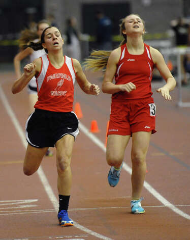 Fairfield Warde's Hannah Dougherty, left, finishes first in the 600 meter event during FCIAC Indoor Track and Field Championships in New Haven, Conn. on Thursday January 18, 2013. At right is Greenwich's Julia Marache. Photo: Christian Abraham / Connecticut Post