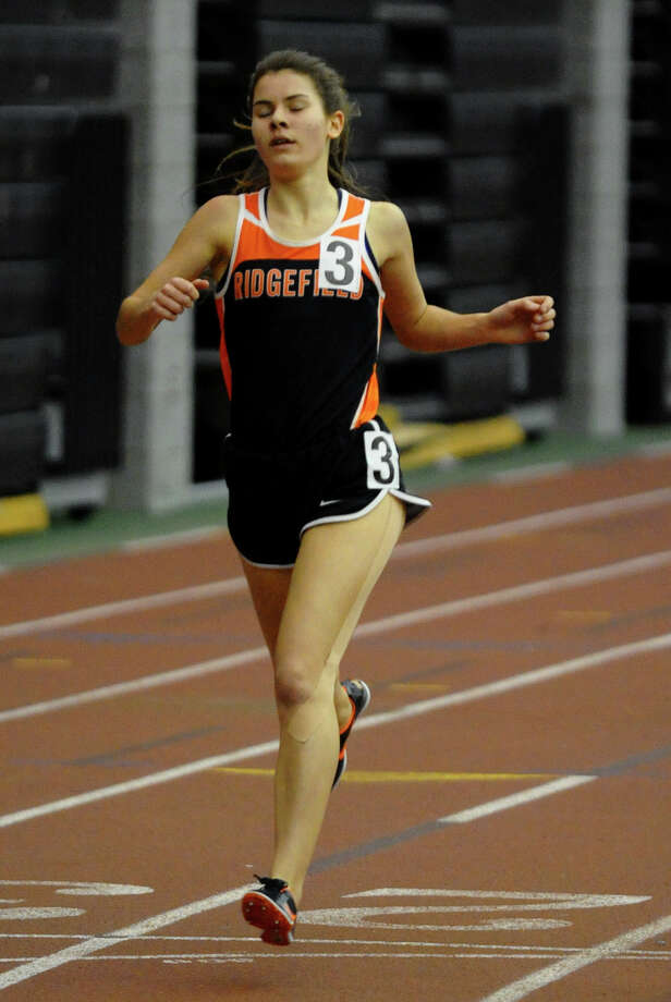 Ridgefield's Laura Hergenrother competes in the 1000 meter event during FCIAC Indoor Track and Field Championships in New Haven, Conn. on Thursday January 18, 2013. Photo: Christian Abraham / Connecticut Post