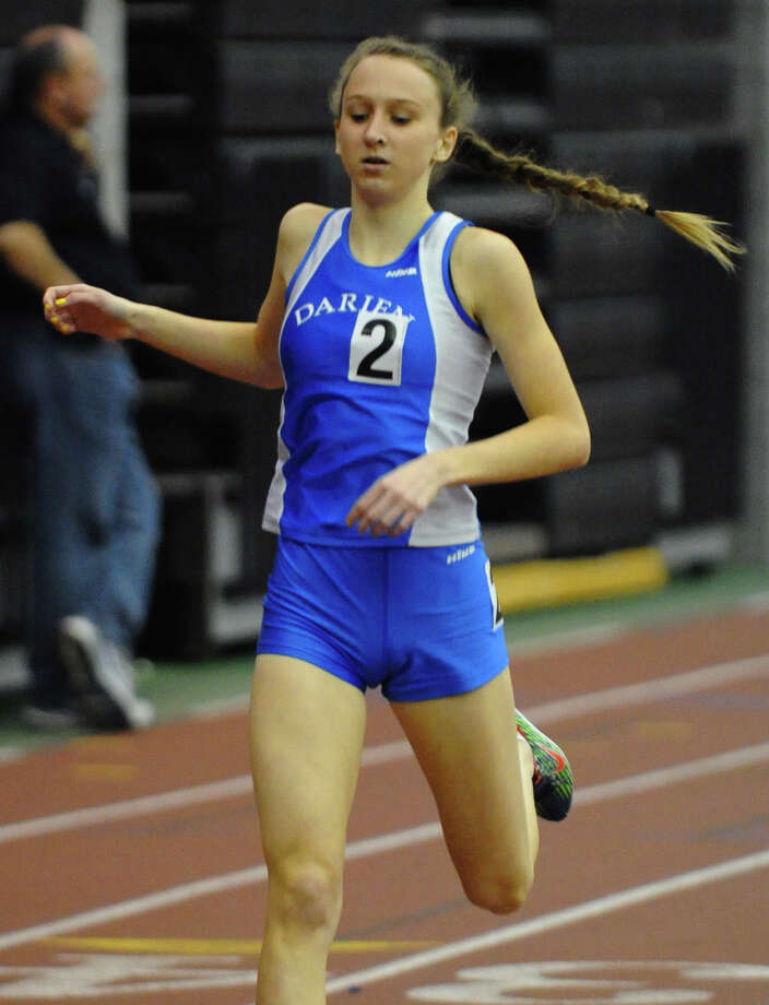 Darien's Grace Loh competes in the 1000 meter event during FCIAC Indoor Track and Field Championships in New Haven, Conn. on Thursday January 18, 2013. Loh finished in first place. Photo: Christian Abraham / Connecticut Post